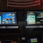 Buzztime poker and trivia video screens